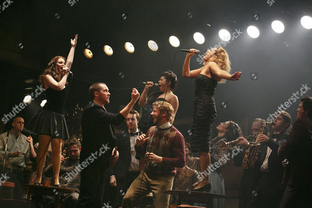 Foreground, 2nd left: Killian Donnelly (Deco), on tables, L-R: Sarah O'Connor (Imelda), Jessica Cervi (Bernie), Stephanie McKeon (Natalie)