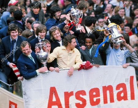 Stock Picture of Football - 1971 Arsenal Double Celebrations - Parade from Highbury to Islington Town Hall Arsenal players parade the FA Cup and League Championship trophies on the open-top bus Islington Town Hall Left to right: Pat Rice Bobby Harding (youth team player) Terry Burton Front: Bob Wilson John Radford Brendon Batson Frank McLintock 09/05/1971 Arsenal Double Parade