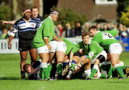 Rugby Union - 1996 / 1997 Courage League - London Irish 31 Bath 56 Irish's scrum half Nick Briers passes the ball away with teammate Liam Mooney left and Bath's Victor Ubogu far left at the Rec 05/10/1996 L Irish 31 Bath 56