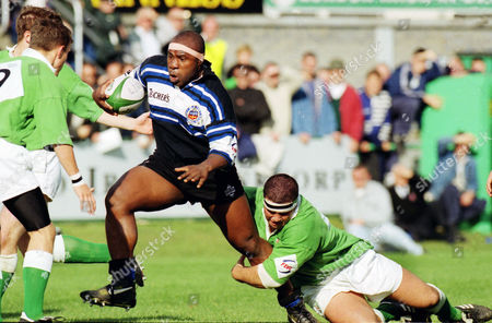Rugby Union - 1996 / 1997 Courage League - London Irish 31 Bath 56 Bath's Victor Ubogu is tackled by Irish's Liam Mooney at the Rec 05/10/1996 L Irish 31 Bath 56