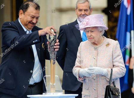 Queen Elizabeth II with President of the Commonwealth Games Federation Prince Imran and Chairman of Games Organiser Lord Smith of Kelvin