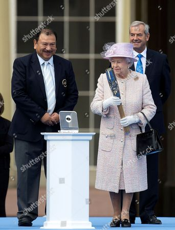 Stock Photo of Prince Imran of Malaysia, Queen Elizabeth II and Chairman of Games Organiser Lord Smith of Kelvin