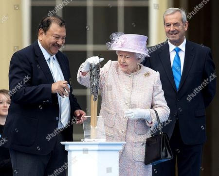 Stock Image of Prince Imran of Malaysia, Queen Elizabeth II and Chairman of Games Organiser Lord Smith of Kelvin