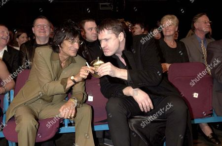 RONNIE WOOD SHARES A DRINK WITH PATRICK BERGIN