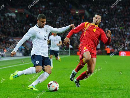 Kyle Walker of England and Milan Jovanovic of Montenegro