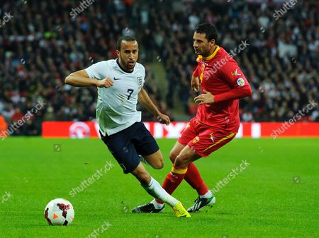 Andros Townsend of England and Milan Jovanovic of Montenegro