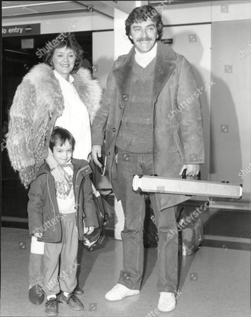 Snooker Player Cliff Thorburn With Wife Barbara And Son Jamie At Lap Clifford Charles Devlin Thorburn Cm Known As Cliff Thorburn (born January 16 1948 In Victoria British Columbia) Is A Retired Professional Canadian Snooker Player. A Former World Number One (one Of Only Ten Players To Hold That Spot) He Was World Snooker Champion In 1980 One Of Only Three Players From Outside The United Kingdom To Win The World Title In The Modern Era (along With Ken Doherty And Neil Robertson). In 1983 Thorburn Became The First Player To Compile A Maximum Break At The World Championships. His Slow Determined Style Of Play Earned Him The Nickname 'the Grinder'.