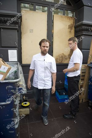 London Riots; The Ledbury Restaurant Ledbury Road Notting Hill. Looters Broke Into The Restaurant Full Of Diners Whilst Staff Defended. Head Chef Brett Graham Coordinates The Staff In Barricading The Premises Ahead Of The Possible 4th Night Of Trouble.