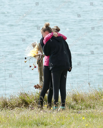 Suicide Of Paul Charles And Wife Jacqueline Charles. The Family Of A Couple Who Died After Their Car Plunged Off A Cliff Top At Culver Down On The Isle Of Wight On Wednesday Night Lay Flowers At The Point On The Cliff Where The Car Went Over The Top. (two Girls Believed To Be The Children Of The Deceased Man But Needs Verifying)