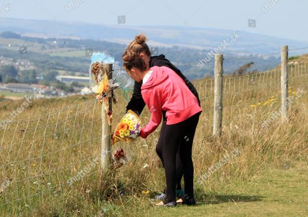 Paul Charles And Jacqueline Charles Died After Their Car Tumbled Off The Cliff At Culver Down On The Isle Of Wight During An Apparent Suicide Pact. The Mother Sister Two Daughters And Two Sons Of Paul James Charles Lay Flowers At The Point On The Cliff Where The Car Went Over The Top.