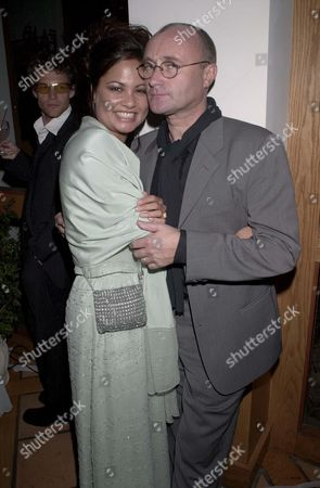PHIL COLLINS AND WIFE
