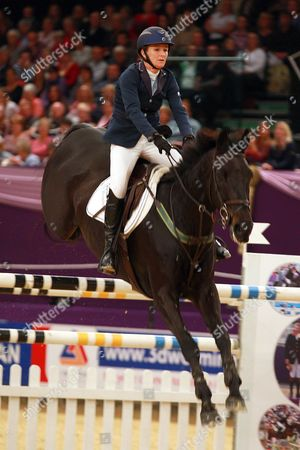 Tina Fletcher (GBR) riding in the Five Fence Challenge