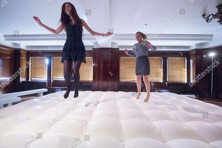 Guests jumping on an installation titled 'Jump' (2013) by Stuart Semple