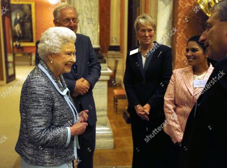 Queen Elizabeth II (left) greets guests including Peter Bottomley (left) and Virginia Bottomley (centre)