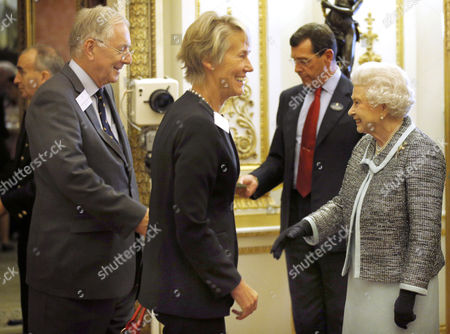 Queen Elizabeth II (right) greets Peter Bottomley (left) and Virginia Bottomley (centre)