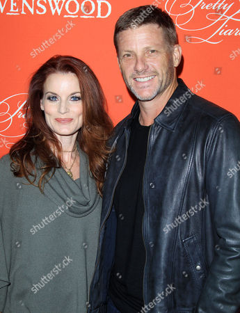 Laura Leighton and Doug Savant