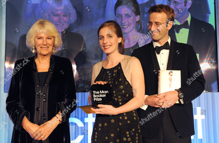 Eleanor Catton (centre) winner of the Man Booker Prize for her book The Luminaries, poses with Camilla Duchess of Cornwall (left) and Robert MacFarlane, Chair of judges (right) after winning the award