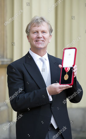Sir Kenneth Gibson, Executive Head teacher, Harton Technology College, Jarrow School, South Tyneside after receiving his Knights Bachelor, for services to Education, at Buckingham Palace.