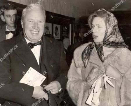 Edward Heath - Politician 1964. Edward Heath Mp And Mrs. June Osborne (now Mrs Jeremy Hutchinson) At The Premiere Of The Film: 'the Yellow Rolls Royce' At The Empire Theatre Leicester Square London. **original Print Held In Kensington** Pkt3825-285800.