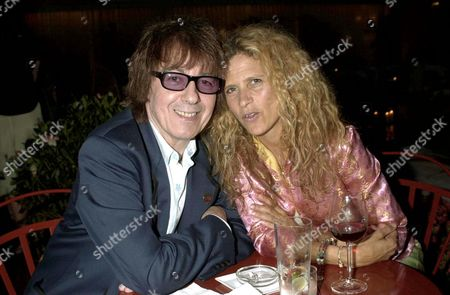 BILL WYMAN AND WIFE SUZANNE AT THE PARTY FOR THE OPENING OF THE SANDERSON HOTEL