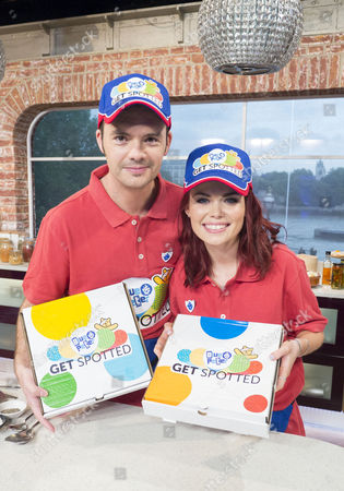Blue Peter presenters Barney Harwood and Lindsey Russell deliver pizzas as part of Children In Need campaign
