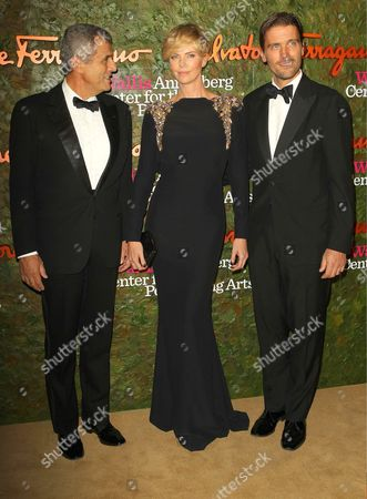 Charlize Theron, James Ferragamo and guest