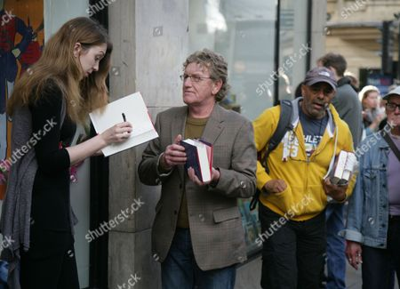 Samantha Shannon signs copies of her book outside Waterstones