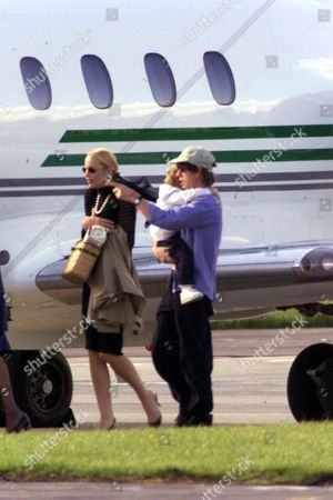 ***PLEASE CREDIT PHOTO'S BY REX FEATURES*** MICK JAGGER ROLLING STONE AND JERRY HALL ARRIVE BACK IN ENGLAND FROM CANNES WITH BABY GABRIEL AFTER LEARNING OF HIS MOTHERS DEATH EARLIER IN THE DAY