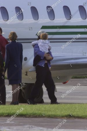 ***PLEASE CREDIT PHOTO'S BY REX FEATURES*** MICK JAGGER AND JERRY HALL ARRIVE BACK IN ENGLAND FROM CANNES WITH BABY GABRIEL AFTER LEARNING OF HIS MOTHERS DEATH EARLIER IN THE DAY