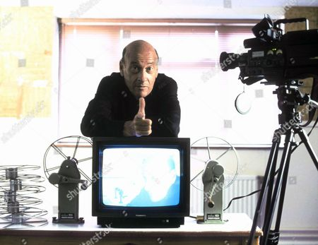 RICHARD LESTER WITH TELEVISION AND VIDEO CAMERA