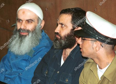 Stock Picture of Courthouse, Tel Aviv, 29.5.2000 Sheikh Abdel Karim Obeid, spiritual leader of the Hezbollah, who was abducted from his home in Lebanon by israeli troups 11 years ago, and Former head of Amal military command Mustafa Dirani, who has been held in Israel for 6 years.For the first time the two are allowed to be seen during a hearing debating prolonged adminstrative detention. Israel has claimed both men have a value as bargaining chips for the release of Israeli navigator Ron Arad, MIA in Lebanon since 1986