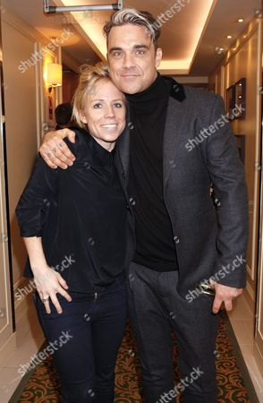 Clemmie Moodie and Robbie Williams