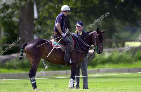 Prince William pictured at polo at the Beaufort polo club with Prince Charles.