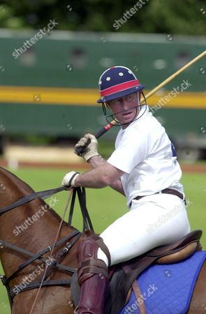 Prince Charles playing polo at the beaufort polo club.