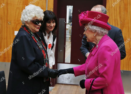 Queen Elizabeth II, right, meets Joan Plowright, left, widow of Sir Laurence Olivier