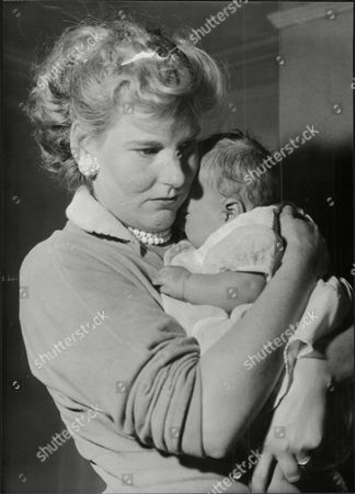 Sheila Winkey Who Changed Her Name To Sheila Sheldon Wife Of Roy Sheldon) Says Goodbye To Her Baby Janet Lee. Mrs Joyce Lee And Husband John Lee Were The Adopted Parents She Gave Her Baby Away Because She Could Not Afford To Keep It.