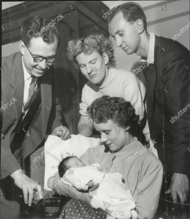 Sheila Winkley Who Changed Her Name To Sheila Sheldon With Her Husband Roy Sheldon Handing Over Their New Baby To Its New Parents John Lee (left) And Wife Mrs Joyce Lee (holding Baby) She Gave Her Baby Away Because She Could Not Afford To Keep It.