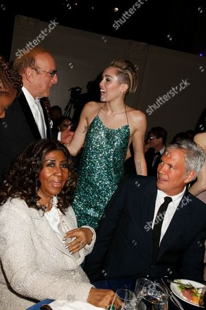 Aretha Franklin, Clive Davis, Miley Cyrus and Robert Duffy