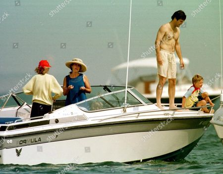 Maria Shriver and son Patrick Schwarzenegger boating with her mother Eunice Shriver, brother Timothy Shriver and his son Samuel Shriver on Monday in Hyannisport
