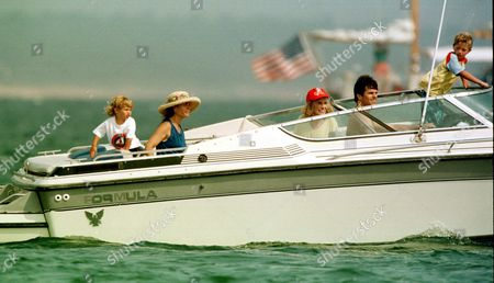 Maria Shriver and son Patrick Schwarzenegger boating with her mother Eunice Shriver, brother Timothy Shriver and his son Samuel Shriver on Monday in Hyannisport.