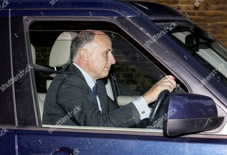 Stock Photo of Jamie Lowther-Pinkerton drives himself from Kensington Palace following the christening