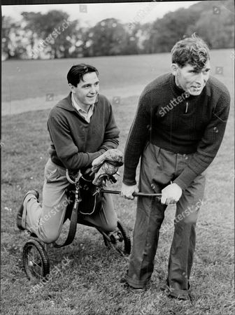Editorial photo of Hibernian Footballer Bobby Johnstone (left) With Eddie Turnbull Playing Golf Robert Johnstone (7 September 1929 Oo 22 August 2001) Was A Scottish Association Football Player Mainly Remembered As One Of The Famous Five Forward Line Of Hibernian. In Hi