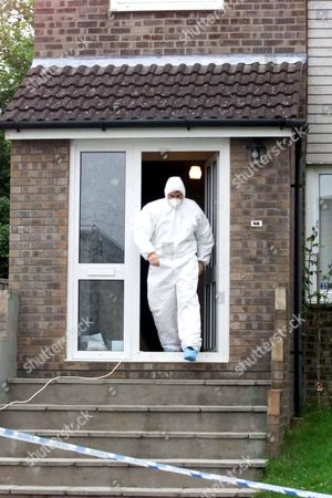 MOCHRIE FAMILY MURDERS,BARRY,WALES-Police leaving the house in Rutland Close