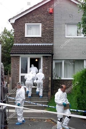 MOCHRIE FAMILY MURDERS,BARRY,WALES-Police entering the house in Rutland Close