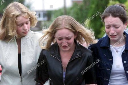 MOCHRIE FAMILY MURDERS,BARRY,WALES-Friends of the family, l-r, Rachel Ford, Claire Harris and Laurie Currie show their emotion at the news of the killings