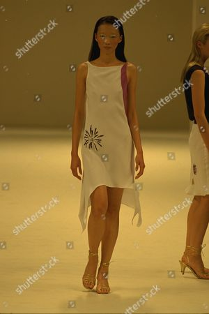 Stock Image of Model On Catwalk In Ben Delisi Designs For London Fashions Week 1997.