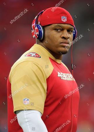 San Francisco 49ers Lawrence Okoye wearing a pair of Dr. Dre Beats headphones with the Union Jack on them