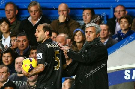 Jose Mourinho's son Jose Mario Jr (top right) looks while his dad the Chelsea manager pats Manchester City's Pablo Zabaleta during todays match