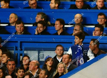 Chelsea's Manager Jose Mourinho son Jose Mario Jr (top right) wears a Chelsea scarf