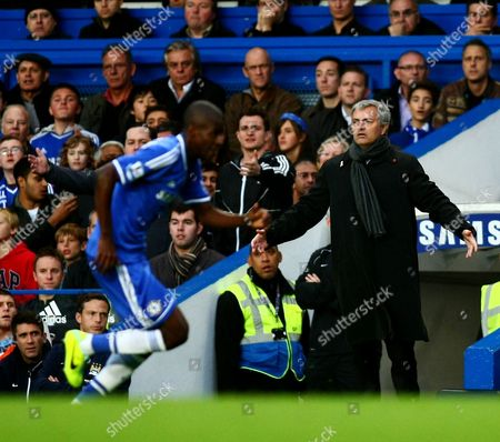 Chelsea's Manager Jose Mourinho looks dejected while his son Jose Mario Jr watches seated directly behind him